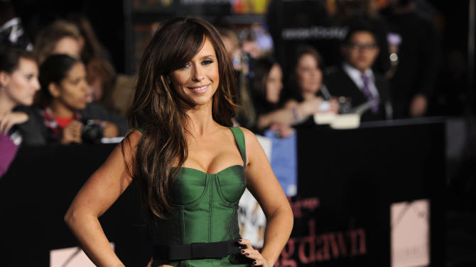 """FILE - In this Nov. 14, 2011 file photo, Jennifer Love Hewitt arrives to the world premiere of """"The Twilight Saga: Breaking Dawn - Part 1"""" in Los Angeles. Love Hewitt temporarily quit Twitter in July 2013, citing """"all the negativity"""" she saw on the service. Twitter burnout among celebrities, athletes and shameless self-promoters poses a risk to the company and its investors as Twitter Inc. prepares for its Thursday, Nov. 7, 2013 initial public offering. (AP Photo/Chris Pizzello, File)"""