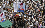 Anti-government protestors and relatives of defected army soldier, who was killed recently in clashes with Yemeni security forces, carry his body during his funeral procession in Sanaa, Yemen, Friday, June 10, 2011. Nearly 100,000 Yemenis are protesting in a main square of the capital demanding the wounded president, currently outside the country, be removed from power. (AP Photo/Hani Mohammed)