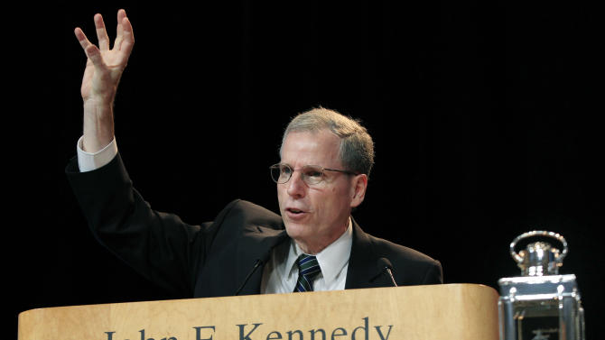 Robert Ford, U.S. Ambassador to Syria, speaks after receiving the 2012 John F. Kennedy Profile in Courage Award at the JFK Library in Boston, Monday, May 7, 2012. (AP Photo/Elise Amendola)
