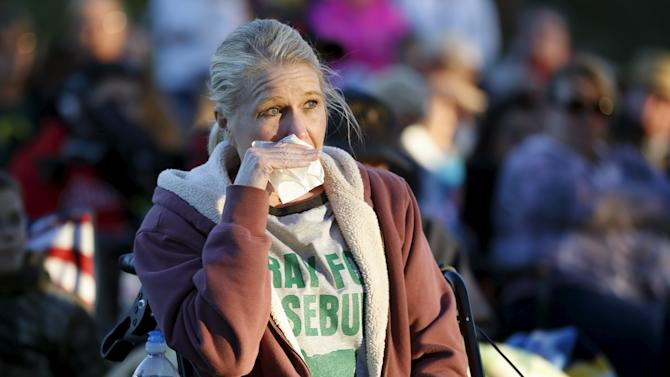 Tammy Hickok takes part in a candlelight vigil for victims of the Umpqua Community College shooting, in Winston