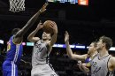 San Antonio Spurs guard Ginobili shoots against Golden State Warriors forward Green during their NBA basketball game in San Antonio, Texas