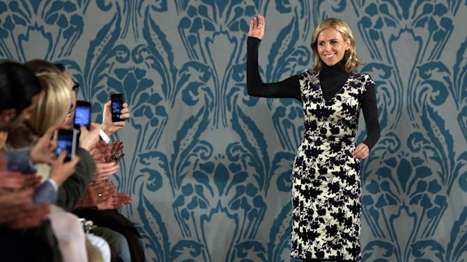 Designer Tory Burch acknowledges audience applause after her Fall 2013 collection was modeled during Fashion Week in New York,  Tuesday, Feb. 12, 2013. (AP Photo/Richard Drew)