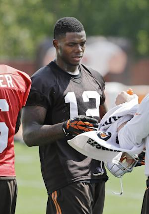 In this Aug. 20, 2014 photo, Cleveland Browns wide receiver Josh Gordon (12) takes a break during practice at the NFL football team's facility in Berea, Ohio. On Wednesday, Aug. 27, 2014, the NFL suspended Gordon for one year for violating the league's substance abuse policy. (AP Photo/Mark Duncan)