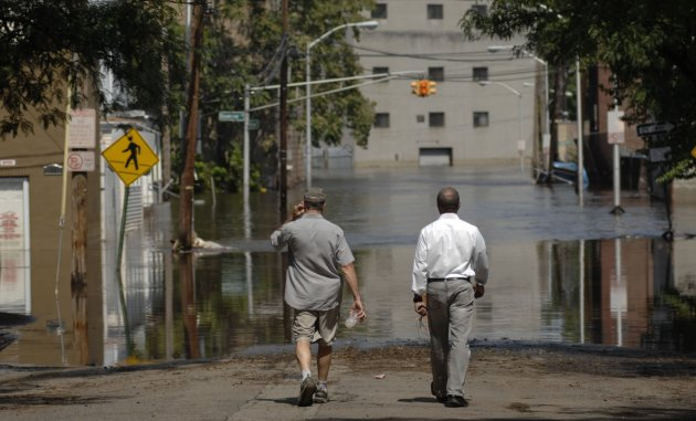 Flood waters from the Passaic River fill the streets, days after Hurricane Irene