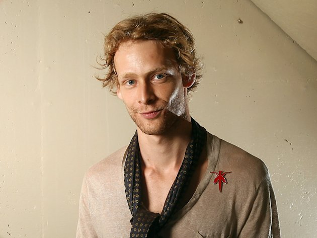 FILE - This Sept. 14, 2011 file photo shows actor Johnny Lewis posing for a portrait during the 36th Toronto International Film Festival in Toronto, Canada. Authorities say Lewis fell to his death after killing an elderly Los Angeles woman. Lewis appeared in the FX television show &quot;Sons of Anarchy,&quot; for two seasons. The woman killed is identified as 81-year-old Catherine Davis. (AP Photo/Carlo Allegri, file)
