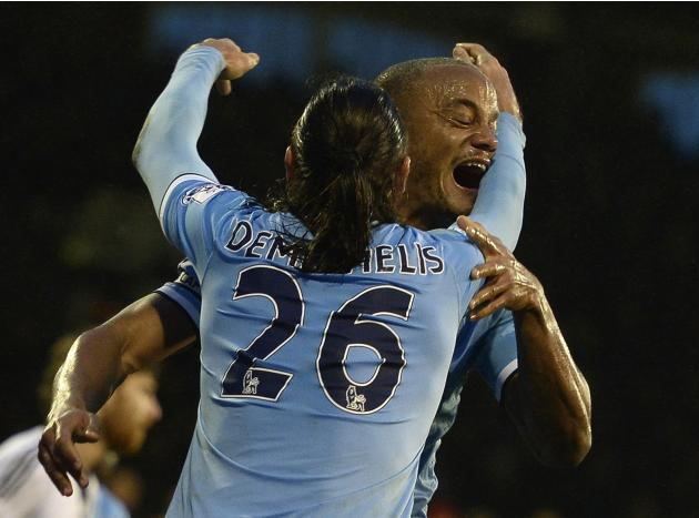 Manchester City's Kompany celebrates scoring his goal against Fulham with Demichelis during their English Premier League soccer match at Craven Cottage in London