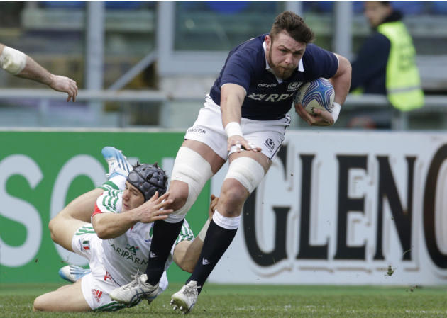 Scotland's Ryan Wilson, right, is tackled by Italy's Michele Campagnaro during a Six Nations rugby union international match between Italy and Scotland, in Rome, Saturday, Feb. 22, 2014. (AP P