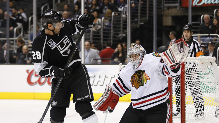 Chicago Blackhawks goalie Corey Crawford, right, stops a shot as Los Angeles Kings' Jarret Stoll watches during the second period of an NHL hockey game in Los Angeles, Saturday, Jan. 19, 2013. (AP Photo/Jae C. Hong)