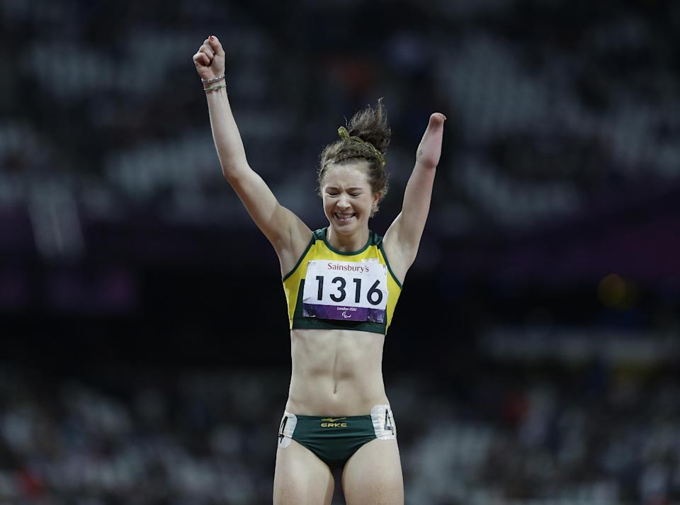 South Africa's Anrune Liebenberg celebrates after finishing second at the women's 200m T46 final race at the 2012 Paralympics in London, Saturday, Sept. 1, 2012. Cuba's Yunidis Castillo, not pictured, won the race. (AP Photo/Lefteris Pitarakis)