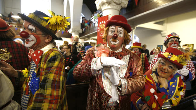 Clowns stand at the pews of the All Saints Church during the Grimaldi clown service in Dalston, north London