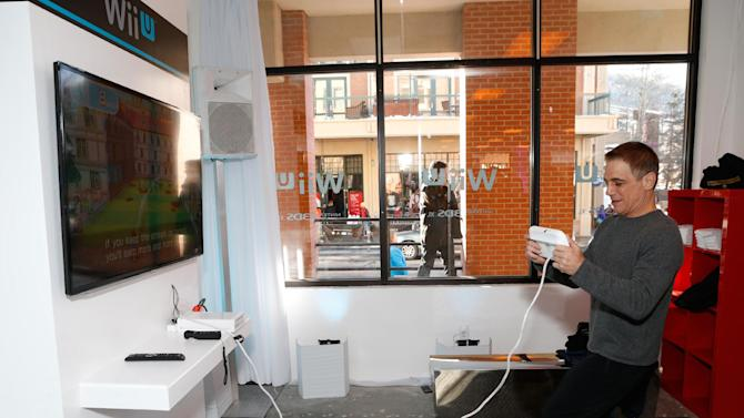 Actor Tony Danza warms up and checks out Wii U at the Nintendo Lounge while playing Wii Fit U during a break from the Sundance Film Festival on Saturday, January 19, 2013 in Park City, UT. (Photo by Todd Williamson/Invision for Nintendo/AP Images)