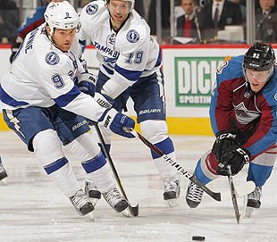 Hockey three-way! Lightning trade Downie to Avs for Quincey, flip Quincey to Wings for 1st | Puck…
