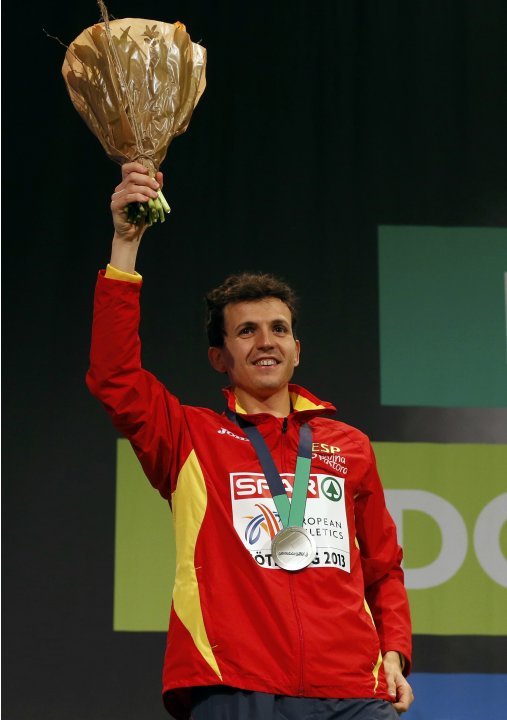 Second placed Higuero of Spain celebrates on the podium during the medal ceremony for the men's 3,000m event at the European Athletics Indoor Championships in Gothenburg
