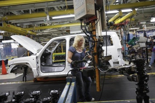 <p>Kim Olszewski installs shocks into a Jeep Liberty on the assembly line at the Toledo Assembly Complex in Toledo in 2011. Four years after the height of the financial crisis, marked by a drastic drop in salaries, the United States is again finding favor among manufacturers.</p>