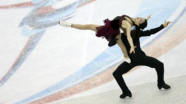Meryl Davis and Charlie White of the U.S. perform during the ice dance free dance competition at the ISU Grand Prix of Figure Skating Final in Sochi (Reuters)