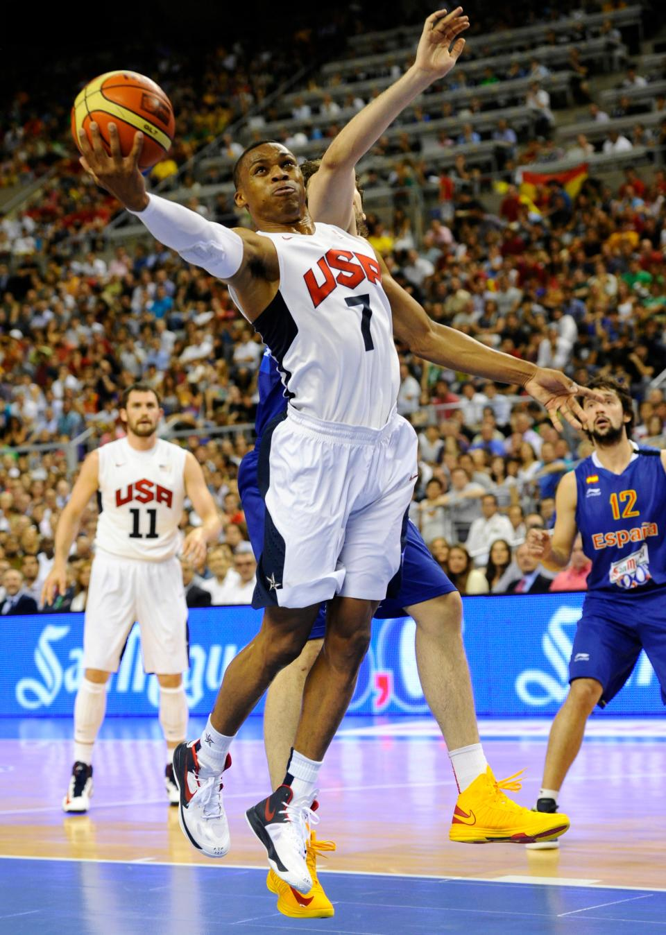 Russell Westbrook of the US Men's Senior National Team, left, jumps for the ball during an exhibition match between Spain and the United States Tuesday, July 24, 2012, in Barcelona, Spain, in preparation for the 2012 Summer Olympics. (AP Photo/Manu Fernandez)