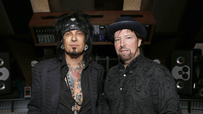 Nikki Sixx and Jack Joesph Puig attend the 98.7 Saves Christmas Party at The House of Rock on Wednesday, Dec. 5, 2012, in Los Angeles, Calif. (Photo by Todd Williamson/Invision for House of Rock/AP)
