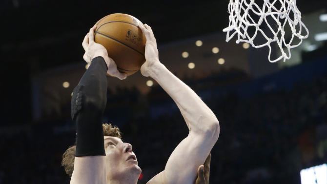 Houston Rockets center Omer Asik (3) shoots in front of Oklahoma City Thunder guard Reggie Jackson (15) in the first quarter of Game 5 of a first-round NBA basketball playoff series in Oklahoma City, Wednesday, May 1, 2013. (AP Photo/Sue Ogrocki)