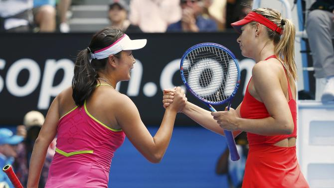 Sharapova of Russia shakes hands with Peng of China after winning their women's singles match at the Australian Open 2015 tennis tournament in Melbourne