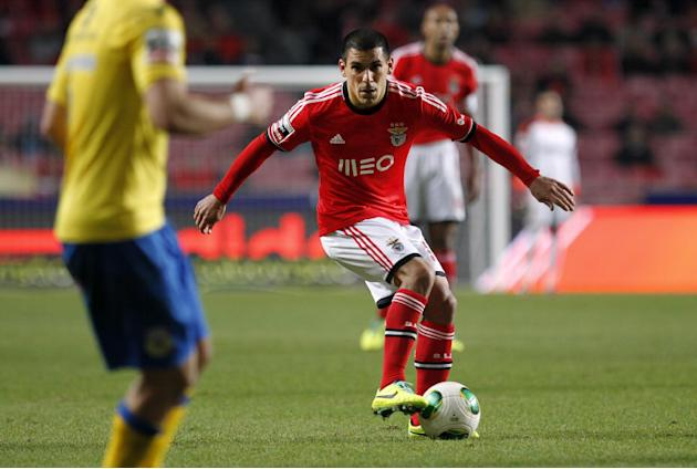 Benfica's Maxi Pereira, from Uruguay, controls the ball during a Portuguese league soccer match between Benfica and Arouca at Benfica's Luz stadium in Lisbon, Friday, Dec. 6, 2013. The match e