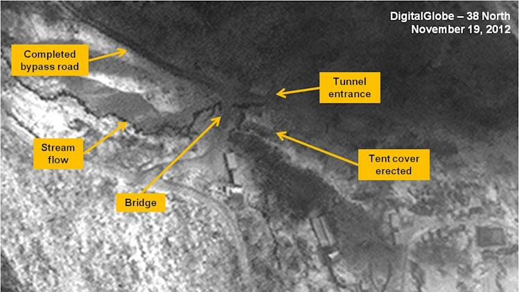 This satellite image taken Nov. 19, 2012 by DigitalGlobe and annotated and distributed Friday, Dec. 28, 2012 by 38 North, the website of the U.S.-Korea Institute at Johns Hopkins School of Advanced International Studies, shows the entrance area of the Punggye-ri Nuclear Test Facility in North Korea, where experts suspect Pyongyang will conduct its next detonation. The 38 North analysis says the repair effort of flood damage seems to have been completed. The analysis says tire tracks now run from the bypass road to the southern area support buildings, the new bridge appears to be wider than before and the tent cover has been raised with the snowfall. (AP Photo/DigitalGlobe via 38 North) NO SALES, MANDATORY CREDIT