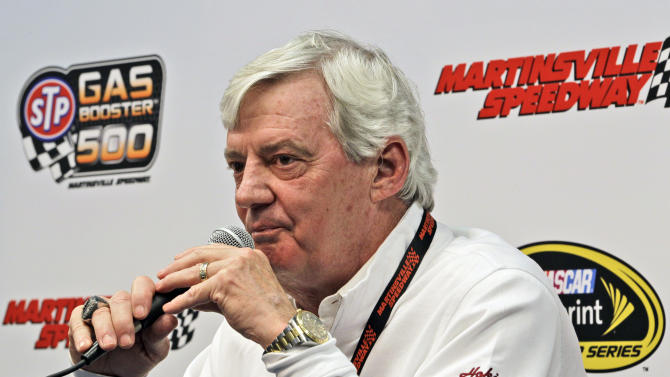 Virginia Tech head football coach Frank Beamer talks to the media prior to the start of the STP 500 Sprint Cup series auto race at Martinsville Speedway in Martinsville, Va., Sunday, April 7, 2013. Beamer will be driving the pace car during Sunday's race. (AP Photo/Steve Helber)