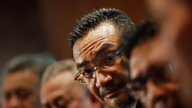 Malaysian acting Transport Minister Hussein ponders a reporter's question during a news conference about missing Malaysia Airlines MH370 at Kuala Lumpur International Airport