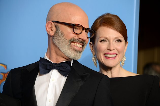"Producer Steve Shareshian, left, and actress Julianne Moore pose with the award for best miniseries or motion picture made for television for ""Game Change"" backstage at the 70th Annual Golden Globe Awards at the Beverly Hilton Hotel on Sunday Jan. 13, 2013, in Beverly Hills, Calif. (Photo by Jordan Strauss/Invision/AP)"