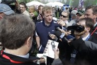NFL Commissioner Roger Goodell, center, is surrounded by reporters during the NFL Play 60 Youth Football Festival, Wednesday, April 25, 2012, in New York. (AP Photo/Mary Altaffer)