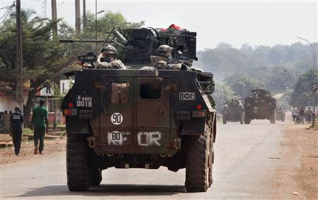 French soldiers patrol on military trucks on the streets in Bangui