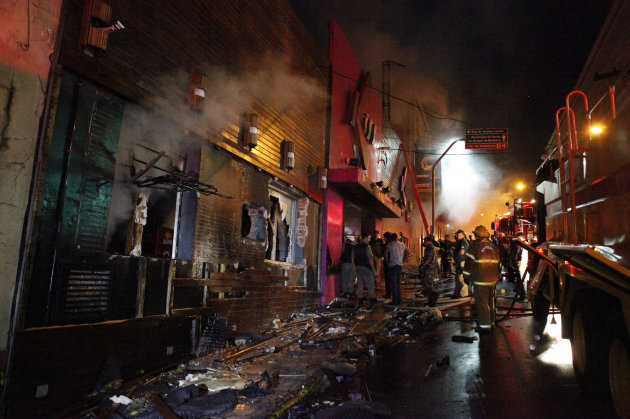 Firefighters work to douse a fire at the Kiss Club in Santa Maria city, Rio Grande do Sul state, Brazil, Sunday, Jan. 27, 2013. Firefighters say that the death toll from a fire that swept through a cr