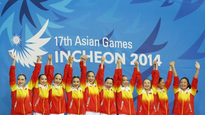 Gold medallists of China celebrate during the victory ceremony for the Teams Free Routine synchronised swimming during the 17th Asian Games in Incheon