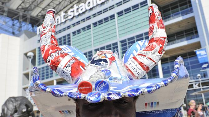 Houston Texans fan Darrin Griffin wears a hat made from Budweiser beer paraphernalia before an NFL football game against the Jacksonville Jaguars Sunday, Oct. 30, 2011 in Houston