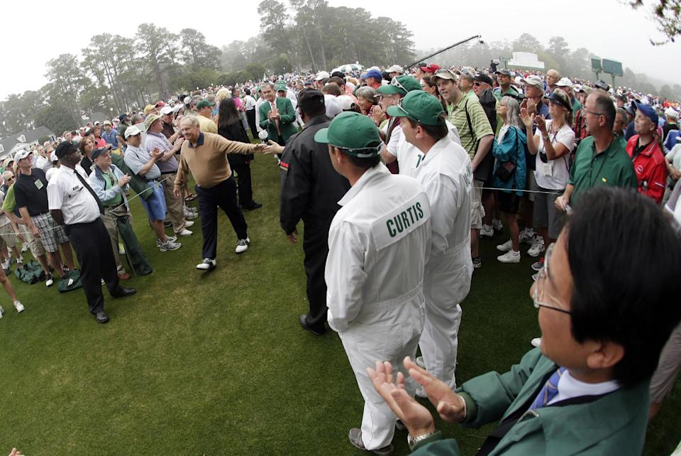 Honorary starter Jack Nicklaus walks to the first tee before the first round of the Masters golf tournament Thursday, April 11, 2013, in Augusta, Ga.(AP Photo/Charlie Riedel)
