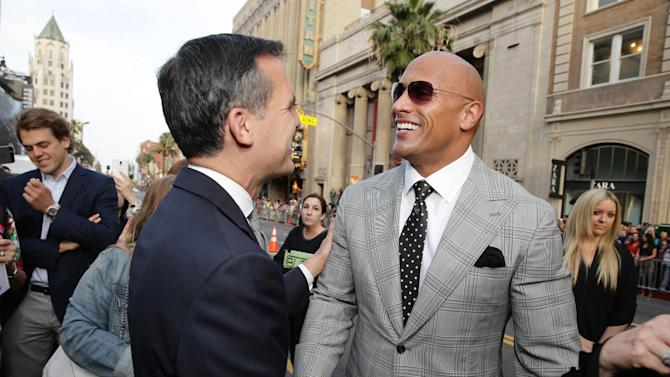 "Mayor of Los Angeles Eric Garcetti and Dwayne Johnson seen at New Line Cinema presents the Los Angeles World Premiere of ""San Andreas"" at TCL Chinese Theatre on Tuesday, May 26, 2015, in Hollywood, CA. (Photo by Eric Charbonneau/Invision for Warner Bros./AP Images)"