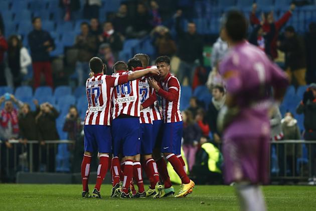 Atletico's Toby Alderweireld celebrates his goal with team mates during a Copa del Rey soccer match between Atletico de Madrid and Sant Andreu at the Vicente Calderon stadium in Madrid, Spain, Wed