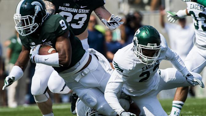 Michigan State defensive back Montae Nicholson recovers a fumble off of a muffed Eastern Michigan catch on a punt kick during the second quarter on Saturday, Sept. 20, 2014 at Spartan Stadium in East Lansing, Mich. Michigan State won 73-14. (AP Photo/The Flint Journal, Jake May)