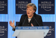 "<p>               German Chancellor Angela Merkel, delivers the opening address at the World Economic Forum in Davos, Switzerland, Wednesday, Jan. 25, 2012. The overarching theme of the Meeting, which will take place from Jan. 25 to 29, is ""The Great Transformation: Shaping New Models"". (AP Photo/Michel Euler)"