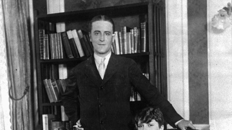 "FILE - This is a 1926 file photo of American author F. Scott Fitzgerald and his wife, Zelda, and daughter, Scotty, in their Paris apartment. Fitzgerald lived in Paris as an expatriate during part of the period he christened ""the Jazz Age."" Fitzgerald is back on the big-screen with Leonardo DiCaprio and director Baz Luhrmann's ""The Great Gatsby,"" a story adapted for film and television more than half a dozen times since the silent-movie era, when it was published to scant sales in 1925. (AP Photo/File)"