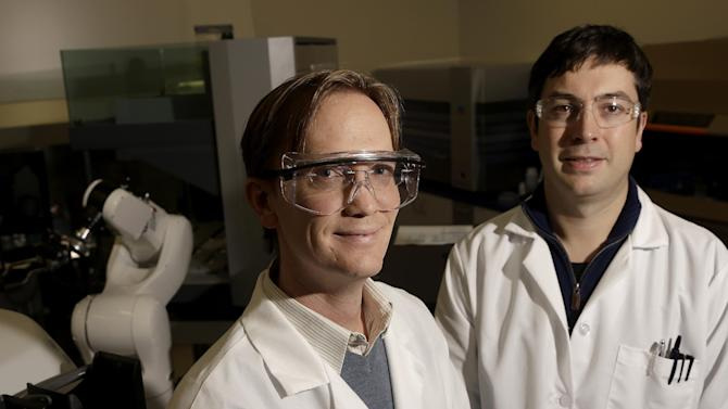 Principal scientists Charlie Holst, left, and Matt Drever pose for photographs at the Pfizer laboratory at the University of California at San Francisco (UCSF) Mission Bay campus in San Francisco, Tuesday, Dec. 18, 2012. Pfizer Inc., Astra Zeneca PLC and Eli Lilly and Co. are among the major international drug companies signing seven-figure, multi-year umbrella agreements with schools such as New York University, Harvard and the University of California-San Francisco. The deals cover a range of research projects and offer campus scientists access to once-proprietary experimental drug compounds owned by the corporate labs. (AP Photo/Jeff Chiu)