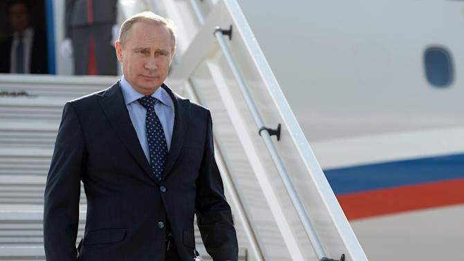 Russia's President Vladimir descends from his plane while arriving in the Volga River city of Samara, July 21, 2014