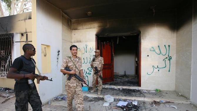 FILE - In this Sept. 14, 2012 file photo, Libyan military guards check one of the burnt out buildings at the U.S. Consulate in Benghazi, Libya, during a visit by Libyan President Mohammed el-Megarif to express sympathy for the death of American ambassador to Libya Chris Stevens and his colleagues in the Sept. 11, 2012 attack on the consulate. The White House has put special operations strike forces on standby and moved drones into the skies above Africa, ready to strike militant targets from Libya to Mali — if investigators can find the al-Qaida-linked group responsible for the attack. (AP Photo/Mohammad Hannon, File)