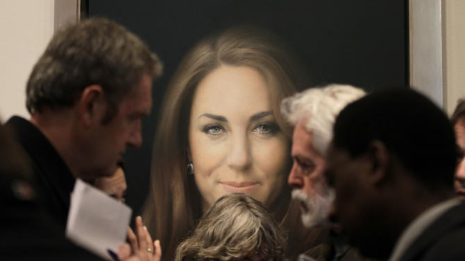 Members of the media talk to artist Paul Emsley, center right, in front of his newly-commissioned portrait of Kate, Duchess of Cambridge, on display at the National Portrait Gallery in London, Friday, Jan. 11, 2013. (AP Photo/Sang Tan)