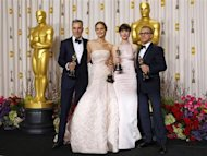 "Daniel Day Lewis (L), best actor for ""Lincoln,"" Jennifer Lawrence, best actress for ""Silver Linings Playbook,"" Anne Hathaway, best supporting actress for ""Les Miserables and Christoph Walz, best supporting actor for ""Django Unchained"" pose with their Oscars backstage at the 85th Academy Awards in Hollywood, California February 24, 2013. REUTERS/Mike Blake"