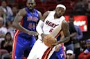 Detroit Pistons' Maxiell Clashes With Miami Heat's James In A Preseason NBA Basketball Game In Miami