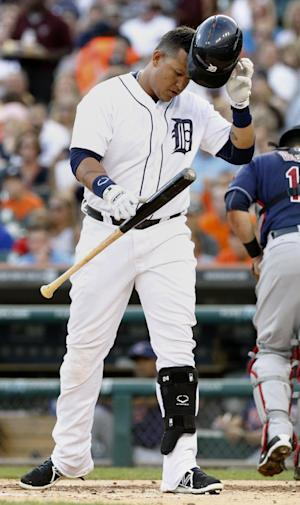 Detroit Tigers' Miguel Cabrera drops his bat and helmet after striking out against Cleveland Indians starting pitcher Zach McAllister in the first inning of a baseball game, Friday, Aug. 30, 2013, in Detroit. Cabrera was pulled from the game after two innings. The Tigers defeated the Indians 7-2 in a seven inning, rain shortened game. (AP Photo/Duane Burleson)