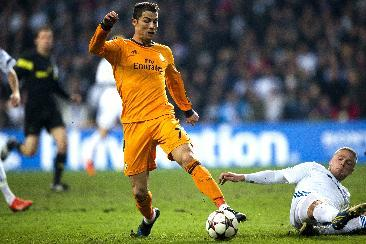 Real Madrid's Christiano Ronaldo , left wins the ball from FC Copenhagen's Ragnar Sigurdsson, during the Champions League, Group B, soccer match between FC Copenhagen and Real Madrid, at Parke