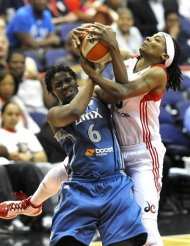 Minnesota Lynx player Amber Harris, left, and Washington Mystics player Dominique Canty battle for the rebound during their basketball game at the Verizon Center, Wednesday, May 30, 2012, in Washington. (AP Photo/Richard Lipski)