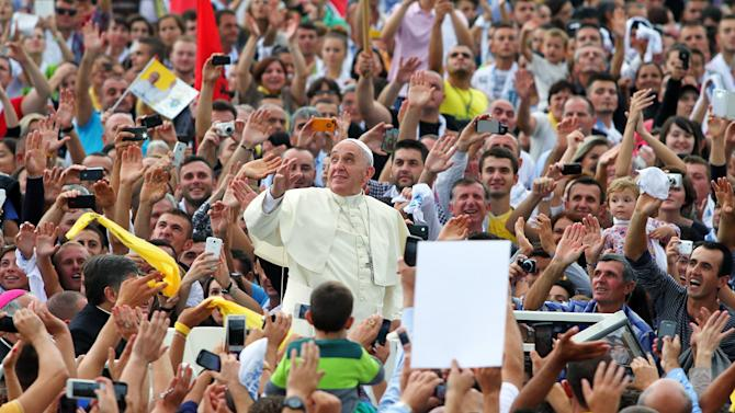 Pope Francis waves during his visit to Albania, in Tirana
