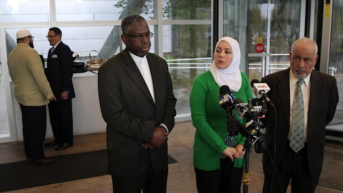 Imam Mustafa El-Amin, center, answers a question as he stands with Nadia Kahf, second right, attorney with the Council on American-Islamic Relations in New Jersey, and Mohamed Younes, right, of Passaic, in Trenton, N.J., Thursday, May 24, 2012, after a meeting between New Jersey Attorney General Jeffrey S. Chiesa and Muslim leaders. Mohamed El-Filali, left, of Paterson, and Imam Wahy-ud Deen Shareef, second left, of Irvington talk aside. Following a three-month review, Gov. Chris Christie's administration said Thursday that New York City police did not violate New Jersey laws when they conducted surveillance of Muslim businesses, mosques and student groups, rejecting demands by Muslim leaders for a formal investigation and a clampdown on cross-border police operations. Attorney General Chiesa, a Christie appointee, was meeting with Muslim leaders to discuss the findings. He said state officials and the New York Police Department have a new agreement to meet regularly to exchange information, and a new directive strengthens notification rules when New Jersey law enforcement learn of operations by outside agencies. (AP Photo/MelEvans)